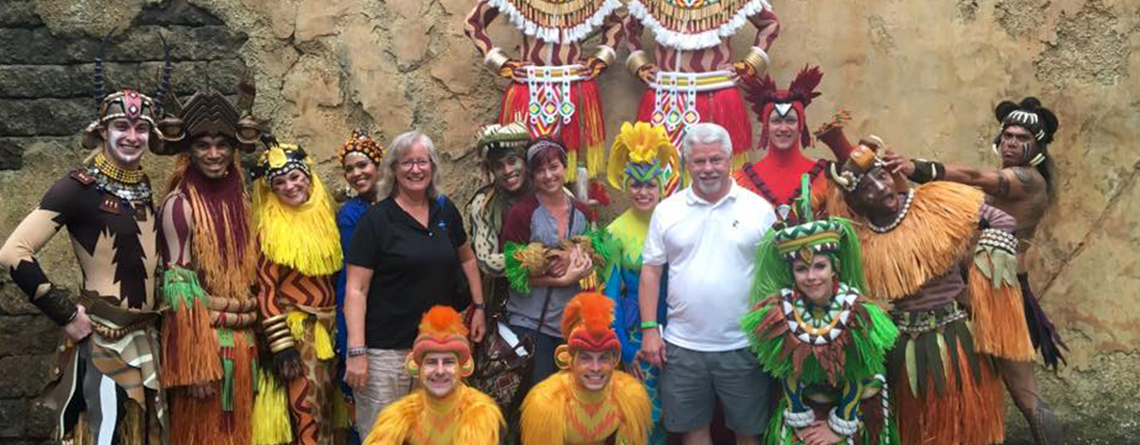 "MTC tour directors Sue Guindon, Paige Carter and Chuck Kubly at ""Festival of the Lion King"" at Walt Disney World."