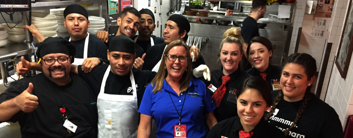 Nancy checking in with the kitchen and wait staff at Buca di Beppo Italian Restaurant before an Educational Destinations dinner.