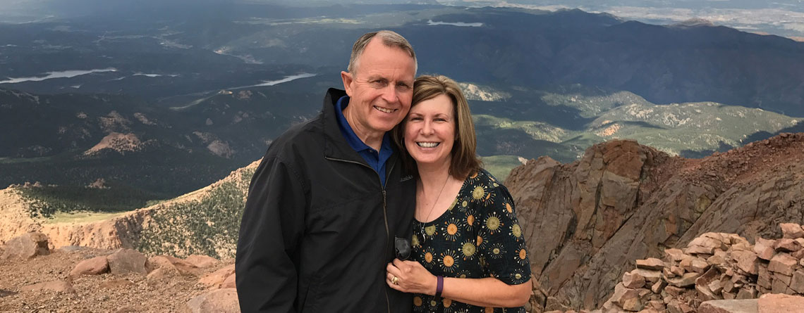 Steve enjoying the views at the top of Pikes Peak with wife, Diane.